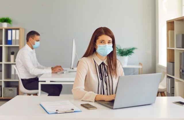 People working with masks on in an office