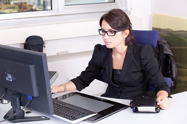 Business woman working on computer at desk