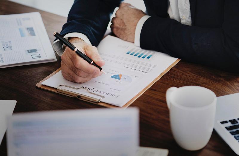 Business man reviewing business financial data