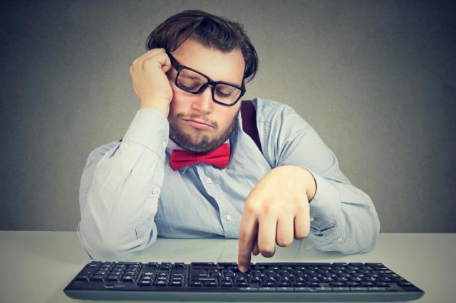 Business Man at Keyboard Procrastinating
